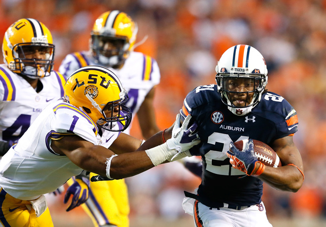 Hi-res-152590922-tre-mason-of-the-auburn-tigers-rushes-away-from-eric_crop_650