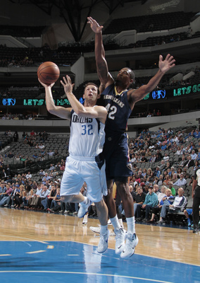 Hi-res-183605903-mickey-mcconnell-of-the-dallas-mavericks-goes-in-for_display_image