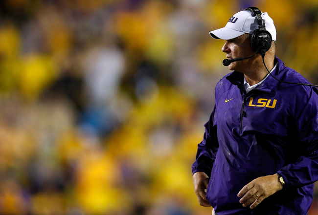 Hi-res-181493297-head-coach-les-miles-of-the-lsu-tigers-stands-on-the_crop_650x440