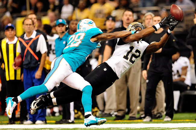 NEW ORLEANS, LA - SEPTEMBER 30:  Nolan Carroll #28 of the Miami Dolphins defends a pass intended for Marques Colston #12 of the New Orleans Saints during a game at the Mercedes-Benz Superdome on September 30, 2013 in New Orleans, Louisiana.  The Saints de