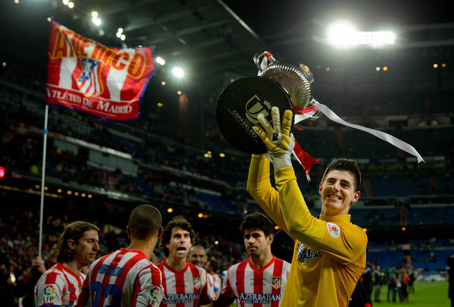 Hi-res-169175629-goalkeeper-thibaut-courtois-holds-the-trophy-in_crop_650x440