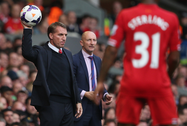 Hi-res-183158653-liverpool-manager-brendan-rodgers-holds-the-ball-during_crop_650x440