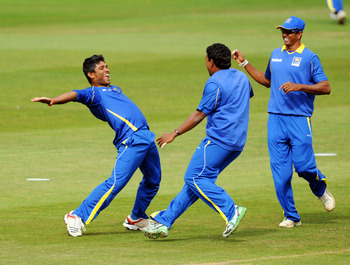 Hi-res-121115407-seekkuge-prasanna-of-sri-lanka-celebrates-with-his-team_display_image