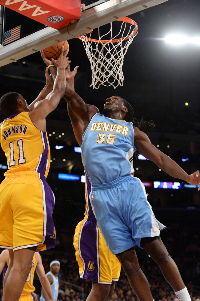 Hi-res-183484635-kenneth-faried-of-the-denver-nuggets-grabs-a-rebound_crop_650