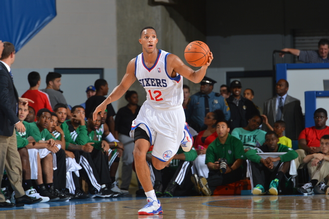 Hi-res-184164165-evan-turner-of-the-philadelphia-76ers-moves-the-ball-up_crop_650