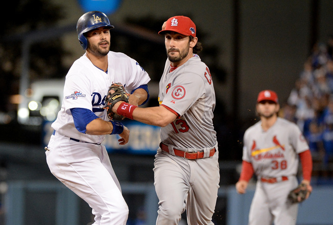 Hi-res-184724595-matt-carpenter-of-the-st-louis-cardinals-tags-out-andre_crop_650x440