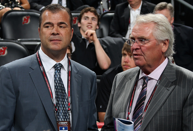 Hi-res-172021374-head-coach-alain-vigneault-and-general-manager-glen_crop_650x440