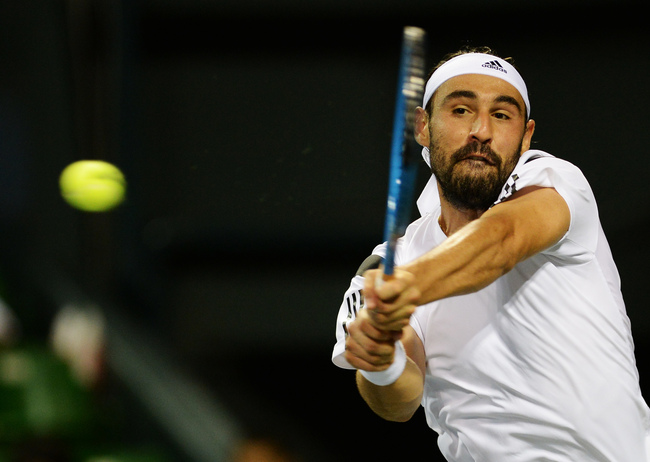Hi-res-182574264-marcos-baghdatis-of-cyprus-in-action-during-his-mens_crop_650