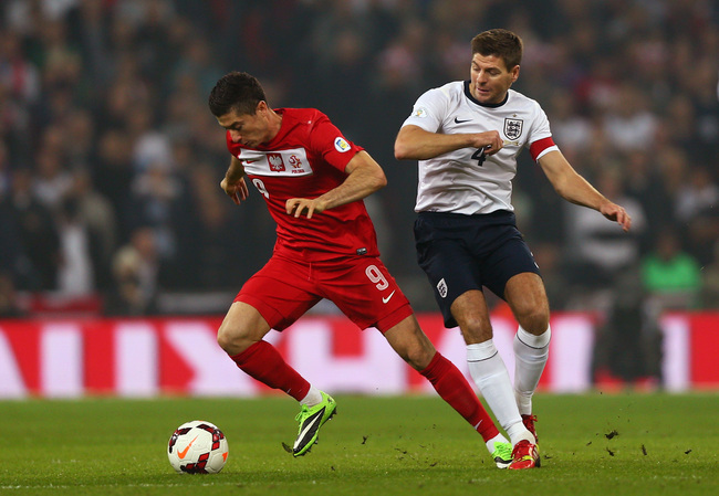 Hi-res-184692394-robert-lewandowski-of-poland-evades-steven-gerrard-of_crop_650