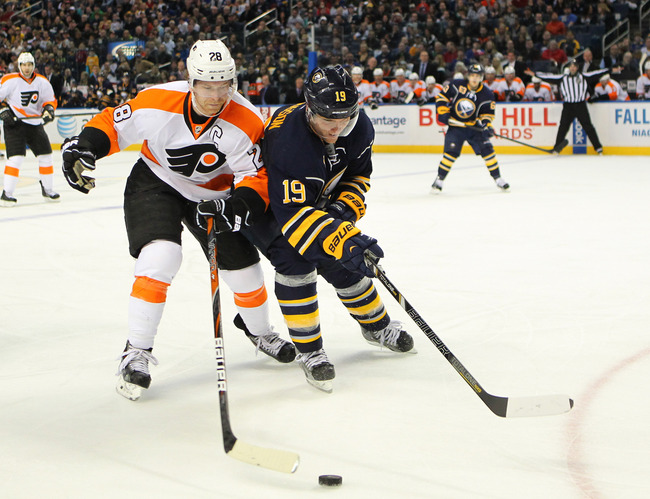 Apr. 13, 2013; Buffalo, NY, USA;  Philadelphia Flyers center Claude Giroux (28) and Buffalo Sabres center Cody Hodgson (19) go after a loose puck during a game at First Niagara Center.  Mandatory Credit: Timothy T. Ludwig-USA TODAY Sports