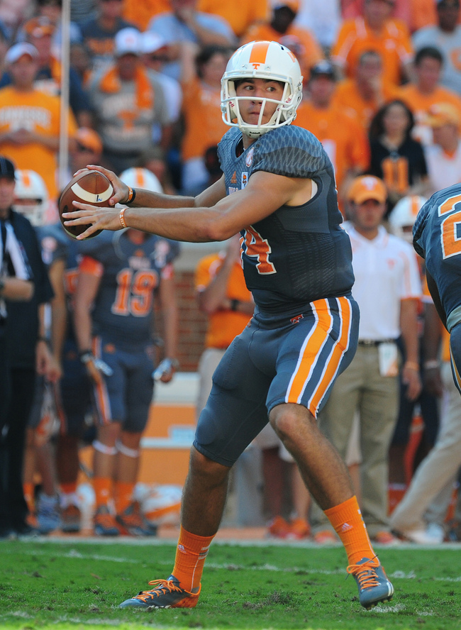 Hi-res-183174750-justin-worley-of-the-tennessee-volunteers-passes_crop_650