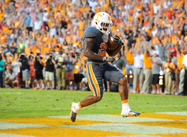 Hi-res-183186571-rajion-neal-of-the-tennessee-volunteers-carries-the_crop_650