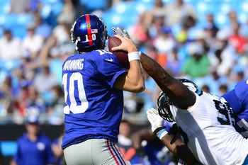 Charles Johnson (95) pressuring the 0-6 Giants' Eli Manning during the Panthers' Week 3 shutout win.