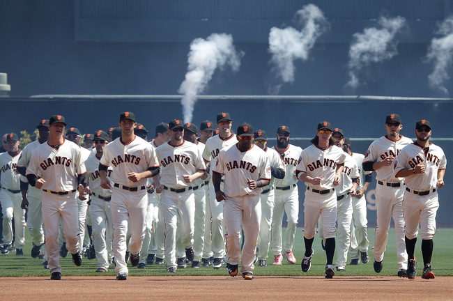Hi-res-111909436-san-francisco-giants-players-take-the-field-before-the_crop_650
