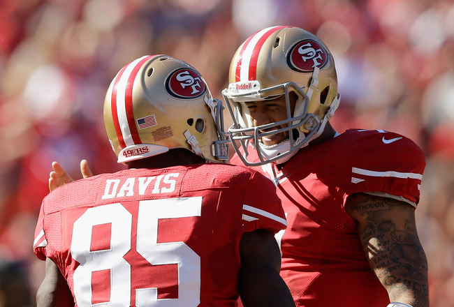 Hi-res-184425094-colin-kaepernick-congratulates-vernon-davis-of-the-san_crop_650x440