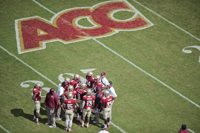 Hi-res-183167543-the-florida-state-seminoles-huddle-during-the-second_crop_650