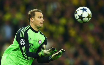 Hi-res-169511102-manuel-neuer-of-bayern-muenchen-catches-the-ball-during_display_image