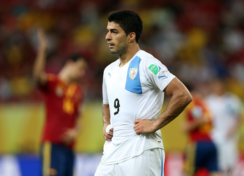 Hi-res-170713800-luis-suarez-of-uruguay-shows-his-dejection-at-the-end_display_image