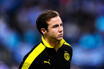 Hi-res-165370183-mario-gotze-of-borussia-dortmund-looks-on-prior-to-the_display_image