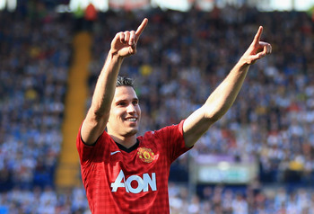 Hi-res-169054908-robin-van-persie-of-manchester-united-celebrates-as-he_display_image