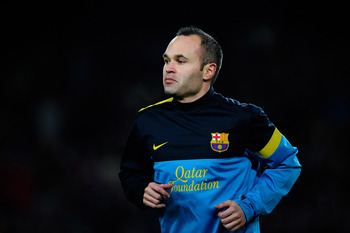 Hi-res-164132865-andres-iniesta-of-fc-barcelona-looks-on-during-the-warm_display_image