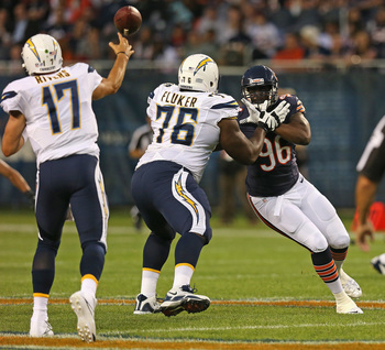 Hi-res-176705484-kyle-moore-of-the-chicago-bears-rushes-against-d-j_display_image