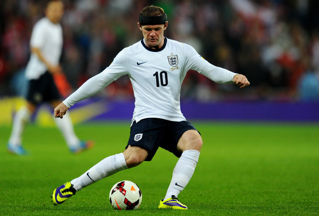 Hi-res-184748166-wayne-rooney-of-england-in-action-during-the-fifa-2014_crop_650x440