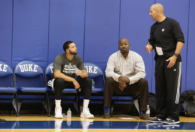 Hi-res-183101231-deron-williams-general-manager-billy-king-and-head_crop_650x440