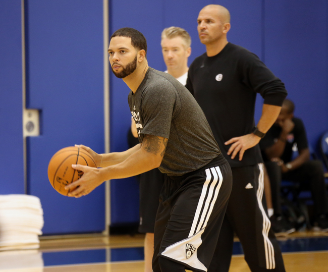 Hi-res-183101372-head-coach-jason-kidd-and-deron-williams-of-the_crop_650