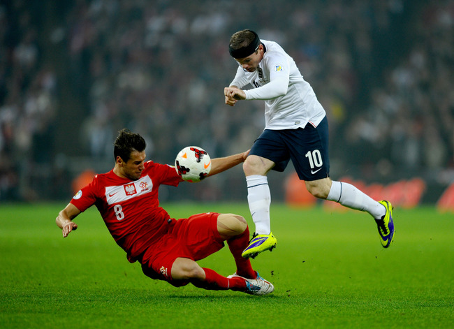 Hi-res-184748379-wayne-rooney-of-england-hurdles-the-challenge-from_crop_650