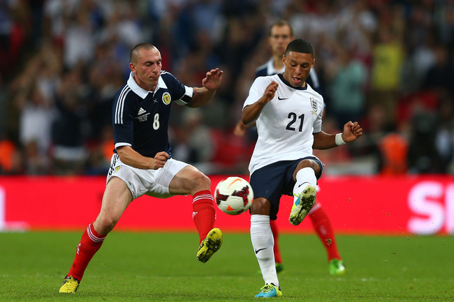 Hi-res-176516679-scott-brown-of-scotland-in-action-against-alex-oxlade_crop_650
