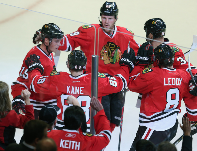 Hi-res-182617445-patrick-kane-of-the-chicago-blackhawks-is-greeted-by_crop_650