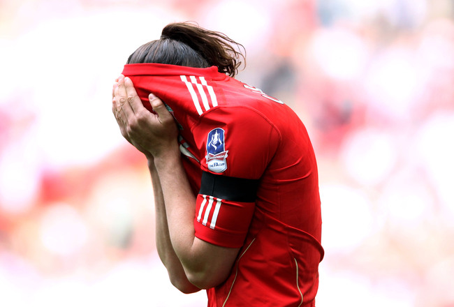 Hi-res-142872303-andy-carroll-of-liverpool-reacts-after-missing-a-chance_crop_650x440