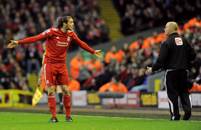 Hi-res-136995187-andy-carroll-of-liverpool-protests-to-the-fourth_crop_650
