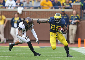 Hi-res-183178861-fitzgerald-toussaint-of-the-michigan-wolverines-runs_display_image