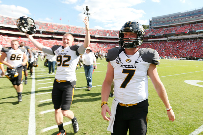 Hi-res-184225945-maty-mauk-of-the-missouri-tigers-celebrates-their-41-26_crop_650