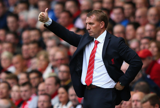 Hi-res-182285304-brendan-rodgers-manager-of-liverpool-looks-on-during_crop_650x440