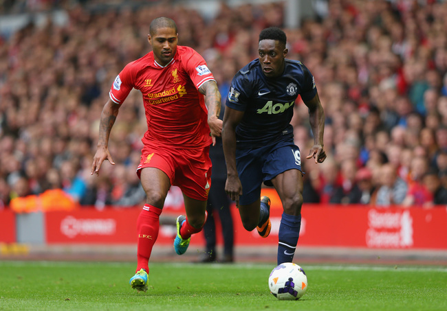 Hi-res-179187682-glen-johnson-of-liverpool-competes-with-danny-welbeck_crop_650