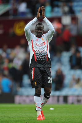 Hi-res-177600865-liverpool-player-aly-cissokho-applauds-the-fans-after_display_image