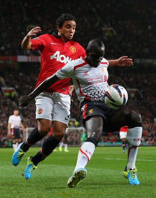 Hi-res-181800342-rafael-of-manchester-united-competes-with-mamadou-sakho_display_image