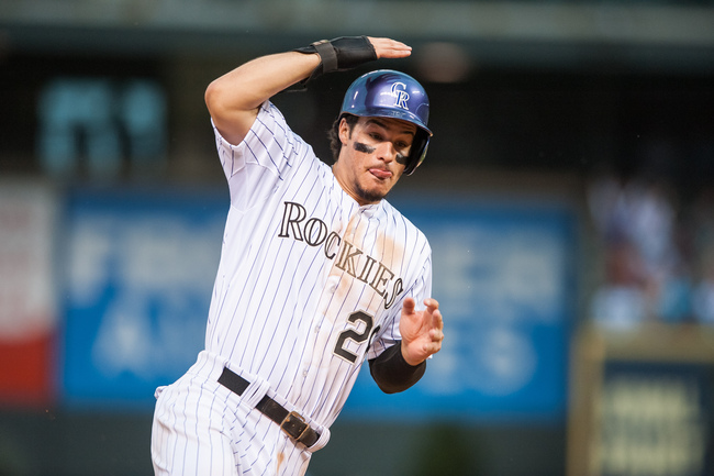 Hi-res-181929568-nolan-arenado-of-the-colorado-rockies-holds-his-helmet_crop_650