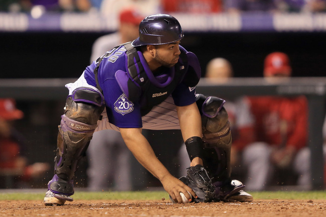 Hi-res-180855961-catcher-wilin-rosario-of-the-colorado-rockies-collects_crop_650