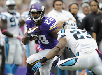 Hi-res-184416345-adrian-peterson-of-the-minnesota-vikings-carries-the_display_image