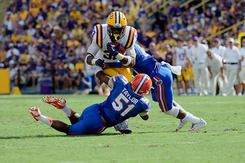 Hi-res-184237545-michael-taylor-of-the-florida-gators-tackles-jeremy_display_image