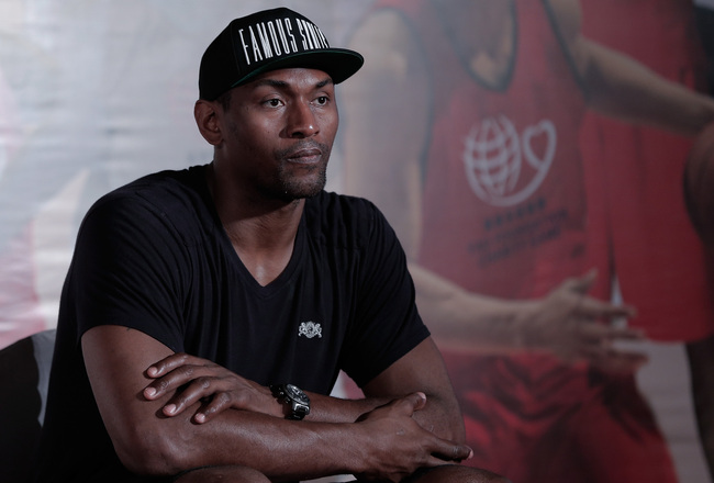 Hi-res-171865357-basketball-player-metta-world-peace-attends-2013-yao_crop_650x440