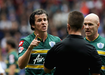 Hi-res-177575720-joey-barton-of-queens-park-rangers-argues-with-referee_display_image