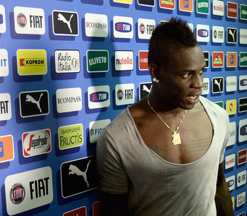 Hi-res-184755066-mario-balotelli-of-italy-walks-through-the-mixed-zone_display_image