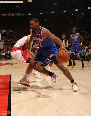 Hi-res-184177294-metta-world-peace-of-the-new-york-knicks-drives-to-the_display_image