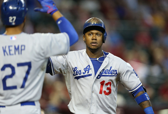 Hi-res-181185643-hanley-ramirez-of-the-los-angeles-dodgers-high-fives_crop_650x440