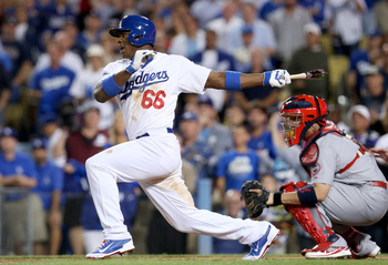 Hi-res-184724607-yasiel-puig-of-the-los-angeles-dodgers-grounds-into-a_display_image